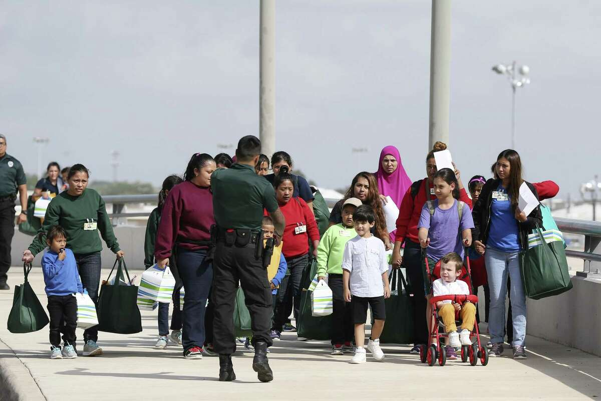 Immigrant families arrive at the San Antonio International Airport from from a family residential center in Dilley, Texas, Tuesday, July 10, 2018. According to some in the crowd, adults were kept with their children at the facility.