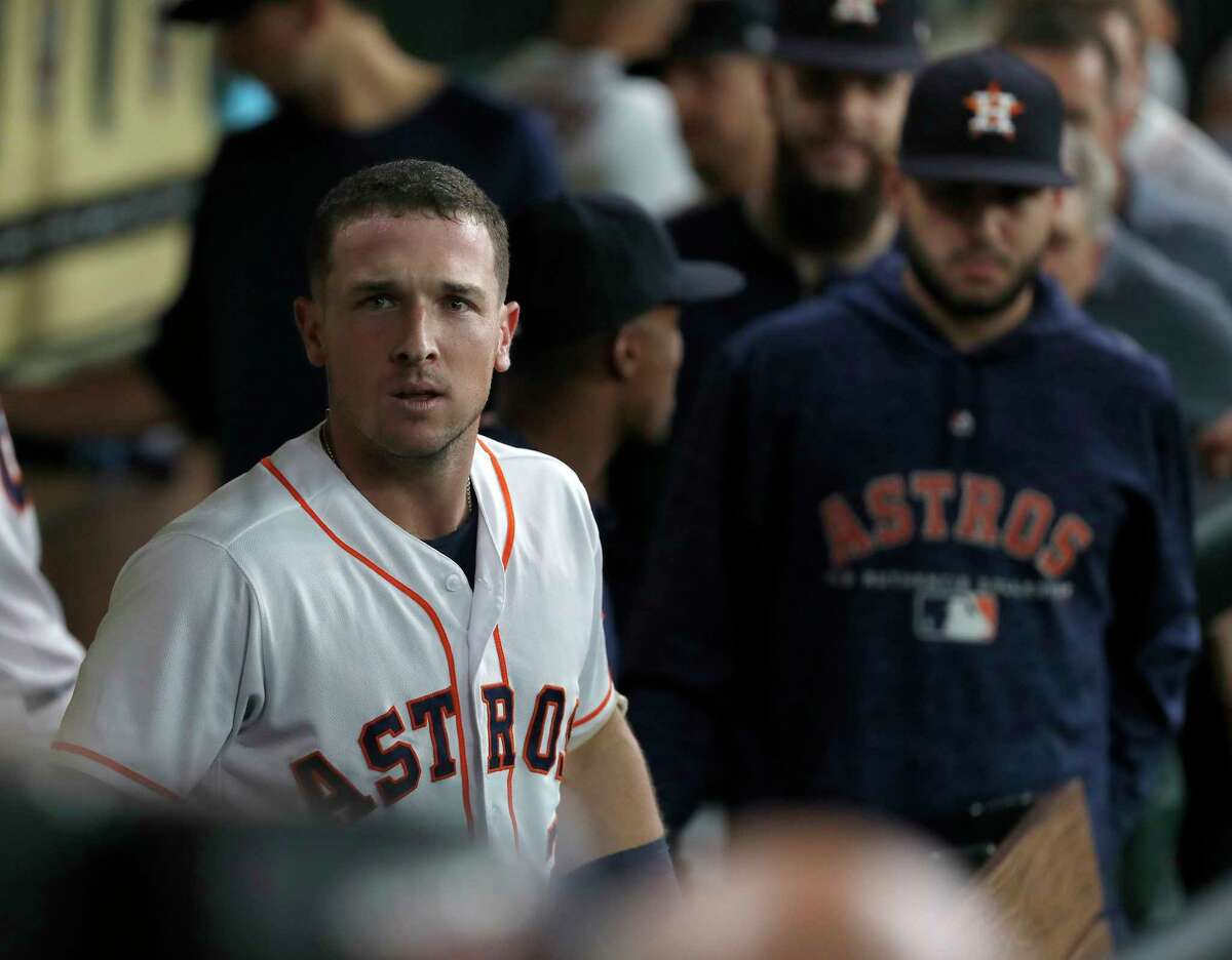 Houston Astros Alex Bregman (2) celebrates with teammates in the dugout after hitting a home run during the first inning of an MLB game at Minute Maid Park, Tuesday, July 10, 2018, in Houston.