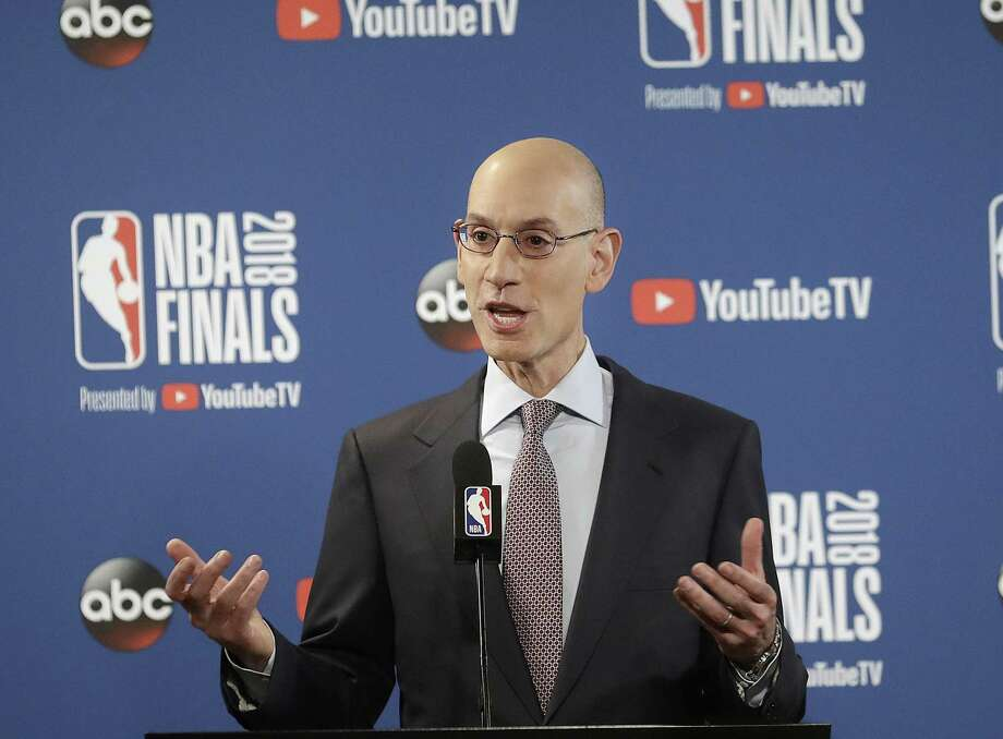 FILE - In this May 31, 2018, file photo, NBA Commissioner Adam Silver speaks at a news conference before Game 1 of basketball's NBA Finals between the Golden State Warriors and the Cleveland Cavaliers, in Oakland, Calif. A diversity report released shows the NBA continues to lead the way in men's professional sports in racial and gender hiring practices. The league earned an A+ for racial hiring practices and a B for gender hiring practices for an overall grade of an A. (AP Photo/Jeff Chiu, File) Photo: Jeff Chiu, STF / Associated Press / Copyright 2018 The Associated Press. All rights reserved.