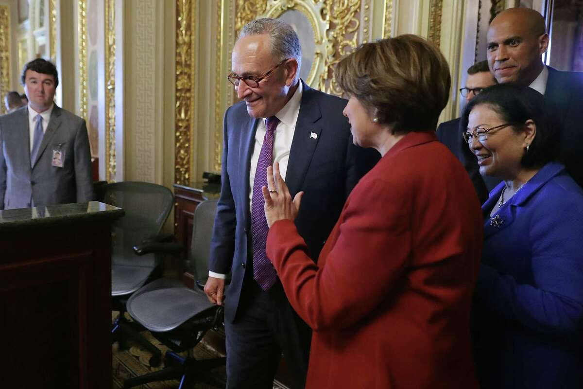 WASHINGTON, DC - JULY 10: (L-R) Senate Minority Leader Charles Schumer (D-NY), Sen. Amy Klobuchar (D-MN), Sen. Mazie Hirono (D-HI) and Sen. Cory Booker (D-NJ) leave their caucus luncheon meeting at the U.S. Capitol July 10, 2018 in Washington, DC. Democrats are facing an uphill struggle to reject President Donald Trump's nominee to the Supreme Court, Judge Brett Kavanaugh. (Photo by Chip Somodevilla/Getty Images)