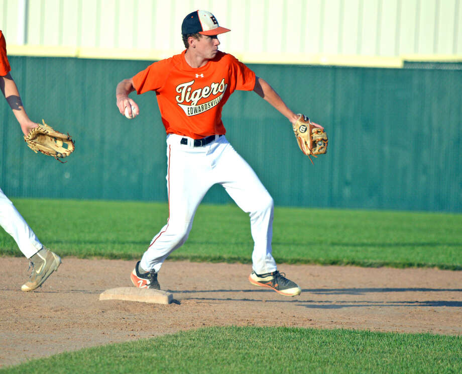 Cameron Grant, the shortstop for the Edwardsville High School 15U summer team, makes a throw to first base to complete a double play in the fourth inning of Tuesday's game against St. Louis Recruits 15U at Tom Pile Field. Photo: Scott Marion