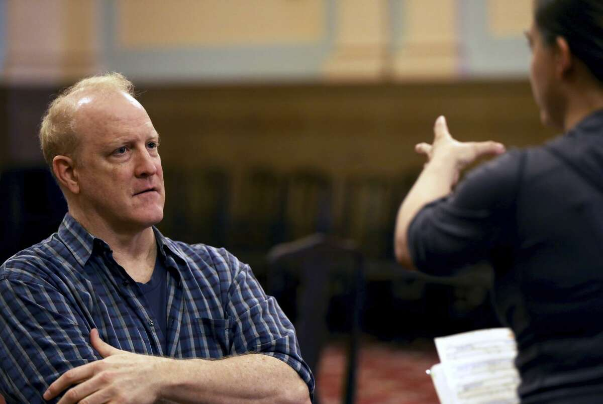 Bass-baritone Philip Skinner (left) listens to director Keturah Stickann during a rehearsal in Berkeley.
