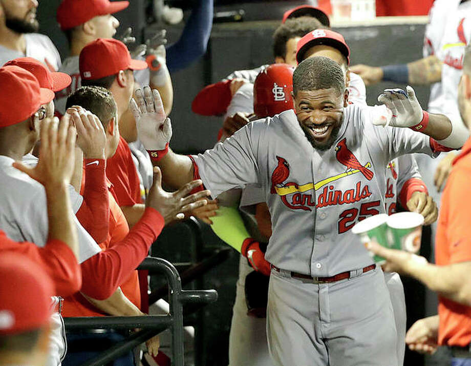 The Cardinals' Dexter Fowler celebrates in the dugout after his grand slam off White Sox relief pitcher Hector Santiago in the sixth inning of Tuesday night's game in Chicago. Photo:       AP