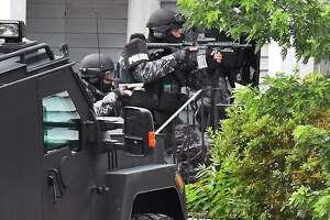 SWAT team members enter 1373 Union Street following the report of a shooting Tuesday July 10, 2018 in Schenectady, NY.  (John Carl D'Annibale/Times Union)
