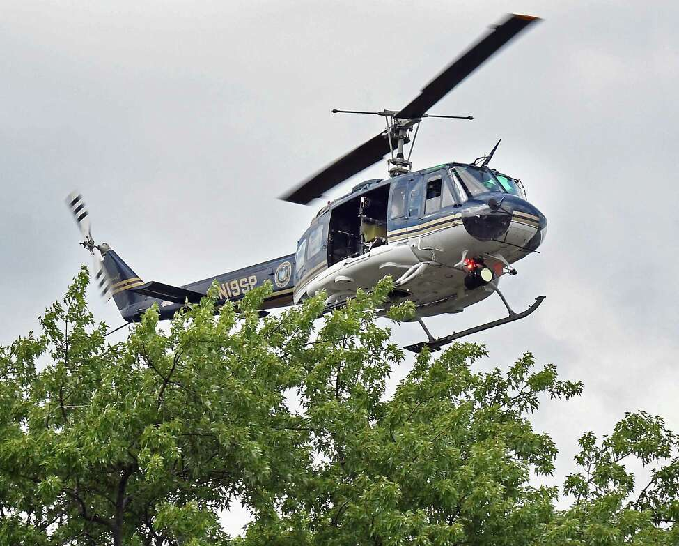 A policeman helicopter hovers over 1373 Union Street following the report of a shooting Tuesday July 10, 2018 in Schenectady, NY. (John Carl D'Annibale/Times Union)