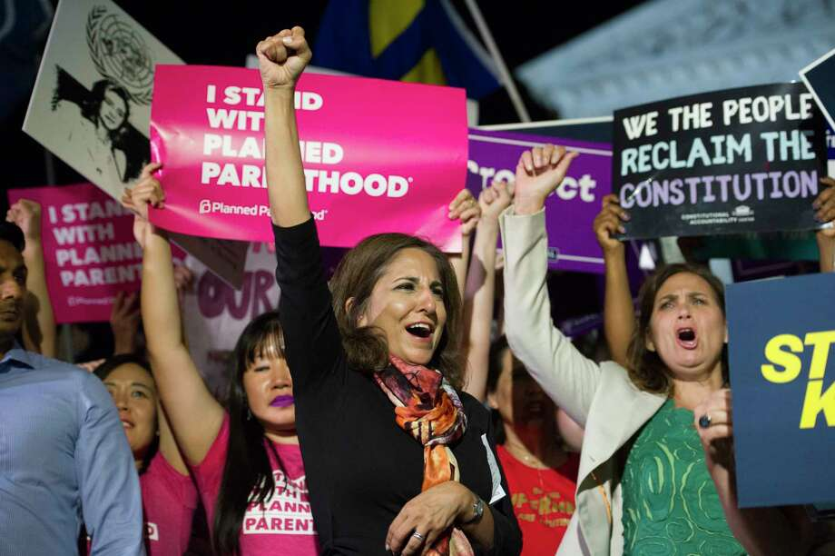Neera Tanden, president, Center for American Progress, center, rallies in front of the Supreme Court in Washington, Monday, July 9, 2018, after President Donald Trump announced Judge Brett Kavanaugh as his Supreme Court nominee. (AP Photo/Cliff Owen) Photo: Cliff Owen / Copyright 2018 the Associated Press. All Rights Reserved.
