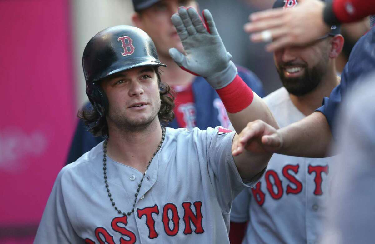 ANAHEIM, CALIFORNIA - JULY 22: Andrew Benintendi #16 of the Boston Red Sox celebrates in the dugout after scoring a run in the first inning against the Los Angeles Angels of Anaheim at Angel Stadium of Anaheim on July 22, 2017 in Anaheim, California. (Photo by Stephen Dunn/Getty Images) ORG XMIT: 700011704