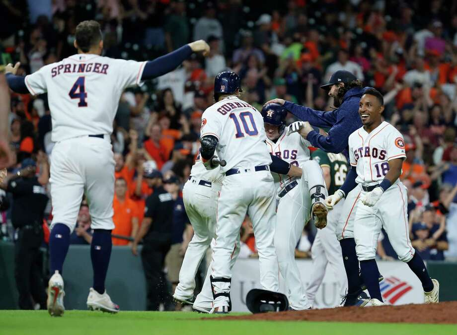 Houston Astros Alex Bregman (2) celebrates after Bregman reached on a single allowing Kyle Tucker to score the winning run during the eleventh inning of an MLB game at Minute Maid Park, Tuesday, July 10, 2018, in Houston. Photo: Karen Warren, Houston Chronicle / © 2018 Houston Chronicle