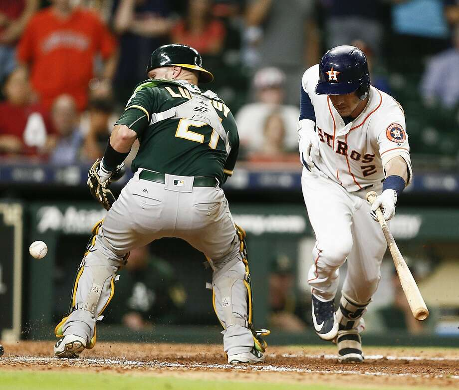 HOUSTON, TX - JULY 10:  Alex Bregman #2 of the Houston Astros hits ground ball to the catcher in the eleventh inning allowing Kyle Tucker #3 on a throwing error by Jonathan Lucroy #21 of the Oakland Athletics letting the winning run score at Minute Maid Park on July 10, 2018 in Houston, Texas.  (Photo by Bob Levey/Getty Images) Photo: Bob Levey / Getty Images