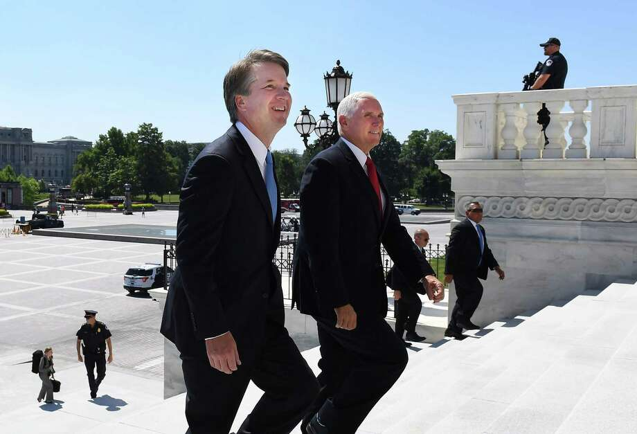 President Trump's nominee for the Supreme Court, Brett Kavanaugh, walks up the Senate steps to the Capitol with Vice President Pence on Tuesday. Photo: Washington Post Photo By Matt McClain. / The Washington Post