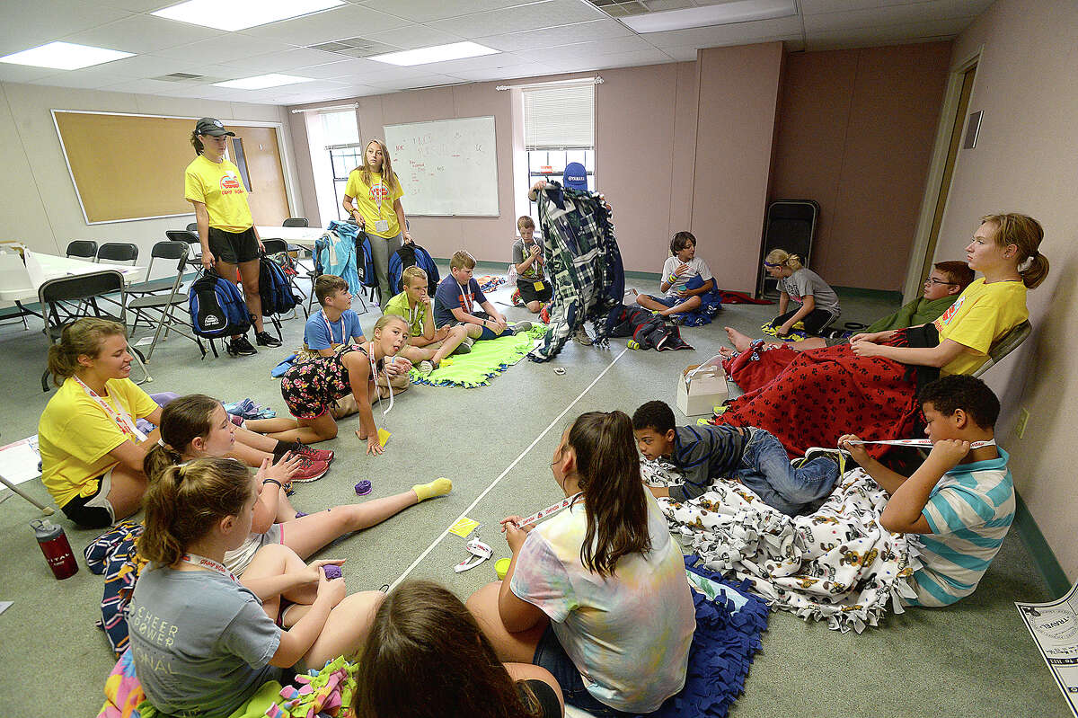 Campers wrap themselves and lay atop their blankets as they await the next activity during Camp Noah at North Orange Baptist Church. The program is helping children deal with the ongoing effects of emotional trauma experienced during Harvey last year. Area schools identified children who were impacted by Harvey, nominating them for the camp, which is being run by members of 2 Lutheran churches in Minnesota. Children are learning ways to prepare for emergencies, and stay safe, as well as cope with the feelings experienced during such disasters. Tuesday, July 10, 2018 Kim Brent/The Enterprise