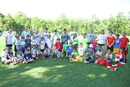 The campers at St. Luke's pose after the sports camp June session.