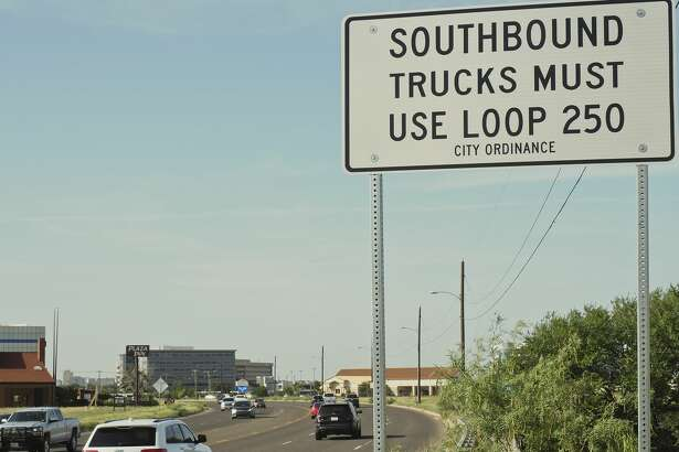 New signs are posted 07/11/18 just south of Loop 250 on Big Spring St. directing trucks to use the loop around Midland.  Tim Fischer/Reporter-Telegram