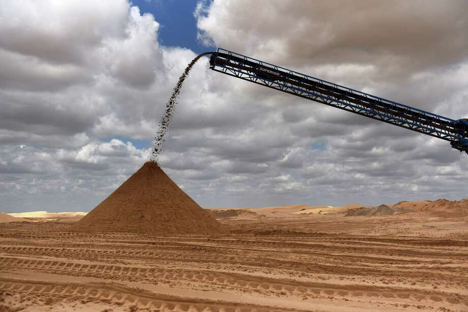 Sand is poured into a pile at the Hi-Crush Partners LP mining facility in Kermit, Texas, on Wednesday, June 20, 2018. In the West Texas plains, frack-sand mines suddenly seem to be popping up everywhere. Twelve months ago, none of them existed - together, these mines will ship some 22 million tons of sand this year to shale drillers in the Permian Basin, the hottest oil patch on Earth. Photographer: Callaghan O'Hare/Bloomberg Photo: Callaghan O'Hare, Bloomberg / © 2018 Bloomberg Finance LP