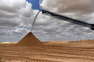 Sand is poured into a pile at the Hi-Crush Partners LP mining facility in Kermit, Texas, on Wednesday, June 20, 2018. In the West Texas plains, frack-sand mines suddenly seem to be popping up everywhere. Twelve months ago, none of them existed - together, these mines will ship some 22 million tons of sand this year to shale drillers in the Permian Basin, the hottest oil patch on Earth. Photographer: Callaghan O'Hare/Bloomberg