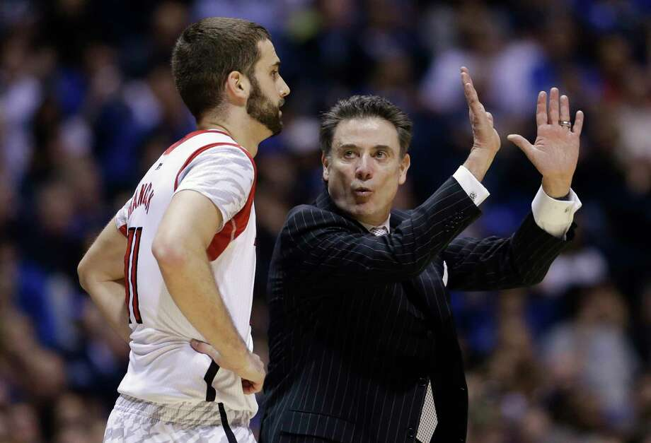 Louisville head coach Rick Pitino talks with Luke Hancock (11) during the second half of the Midwest Regional final in the NCAA college basketball tournament, Sunday, March 31, 2013, in Indianapolis. Louisville won 85-63. Photo: Darron Cummings, AP / AP