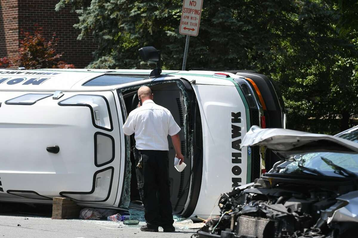 An ambulance and a car collided Wednesday at the intersection of Quail Street and Woodlawn Avenue in Albany. It was unclear if anyone was badly injured in the crash. The impact caused the ambulance to roll into its side.