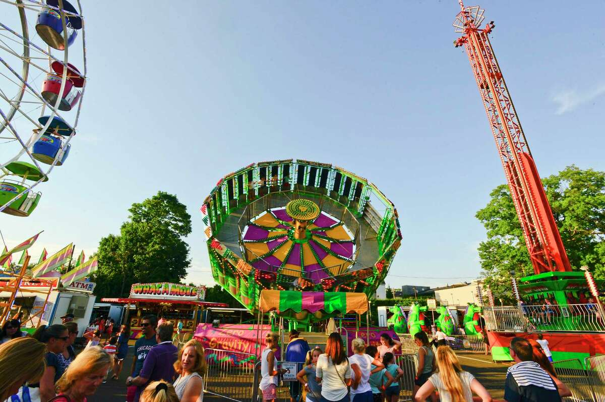 Crowds enjoy carnival rides at the St. Catherine of Siena Church annual Carnival of Fun on July 10, 2018 in Greenwich, Connecticut. The community event features food, games and carnival rides runs from Tuesday, July 10 thru Saturday, July 14.