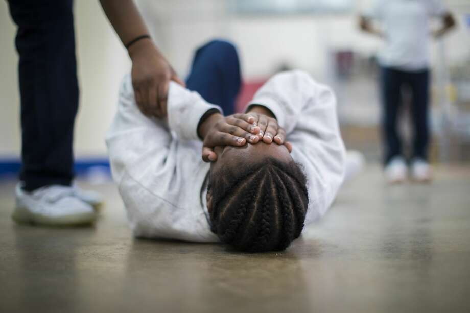 Harris County Juvenile Facility theatre student covers her face as she re-enacts a domestic violence scene, Friday, June 15, 2018, in Katy. Photo: Marie D. De Jesús