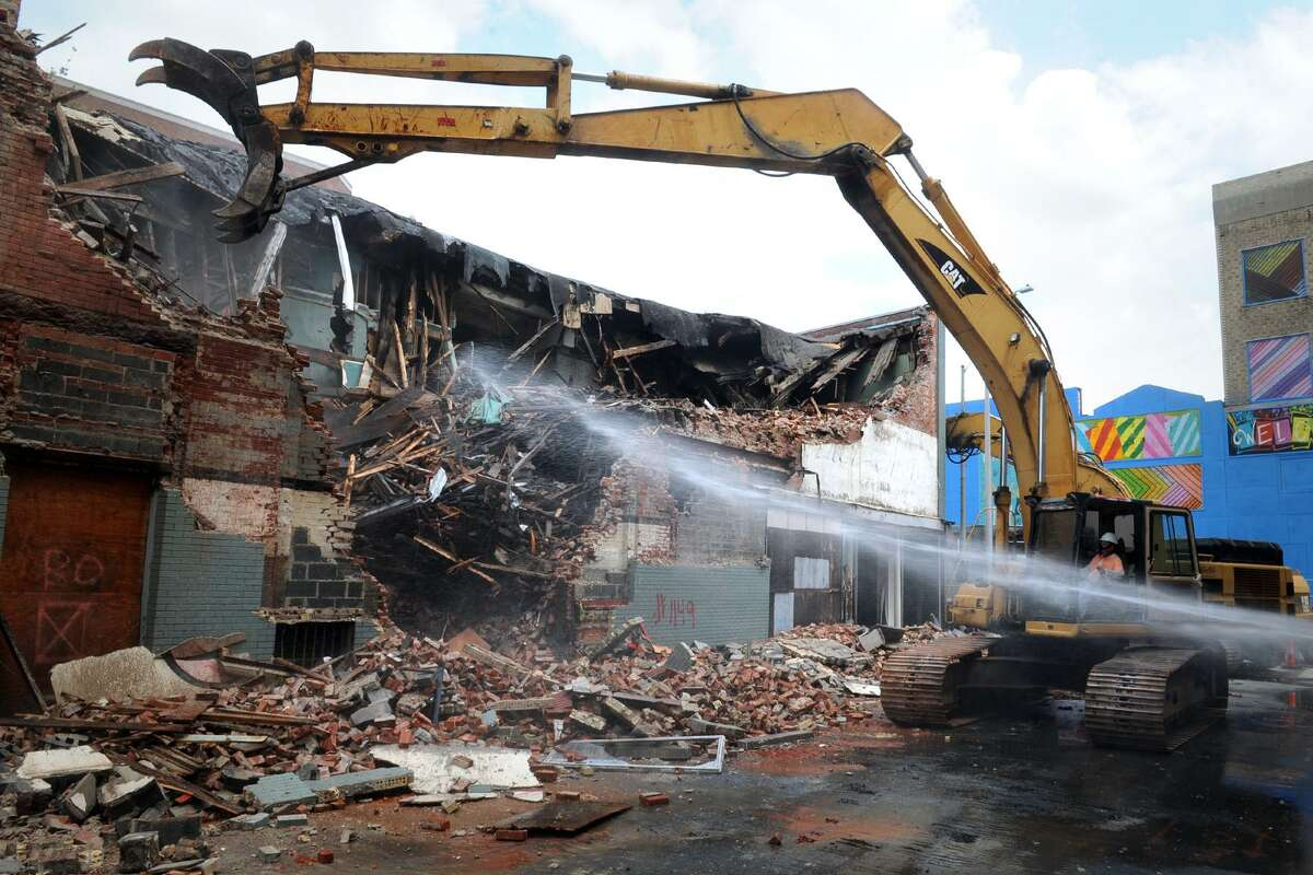 Demolition began Wednesday on an old commercial building at the intersection of Main and Elm Streets, in downtown Bridgeport. Seen here from Elm Street, the building was home to Corbits Photography Studio, which was located at 2 Elm St. for most of the 20th century. The demolition is part of the ongoing Downtown North redevelopment project. The space will be used as parking and a garden for the planned Bridgeport Amsterdam Tulip Museum.
