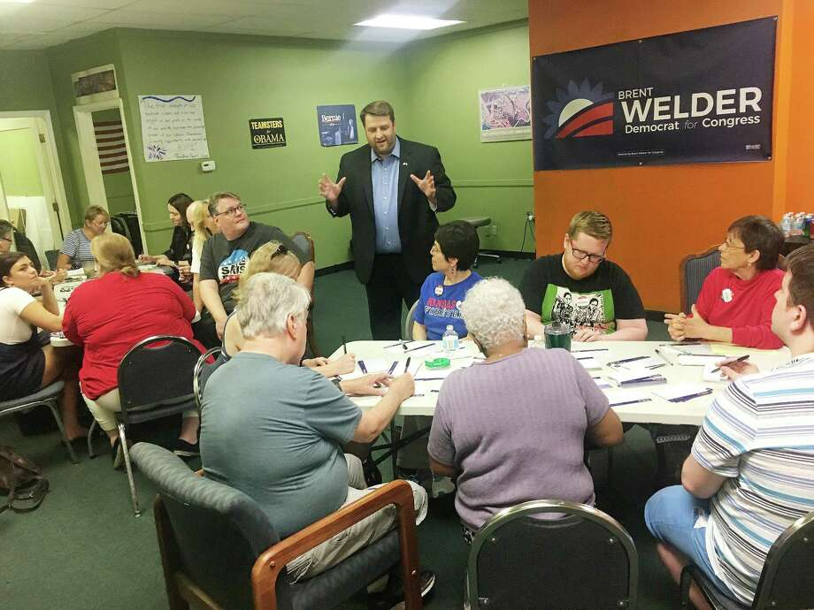 Brent Welder, a Democrat running for Congress in Kansas, talks with volunteers at his campaign office on July 3. Photo: Washington Post Photo By David Weige / The Washington Post