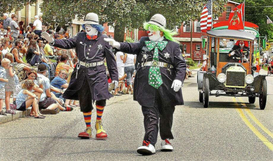 Members of the Funsters Sphinx Shriners of Newington, Fizz-Bo and Bubbles, march in East Hampton's Old Home Days parade. Photo: File Photo