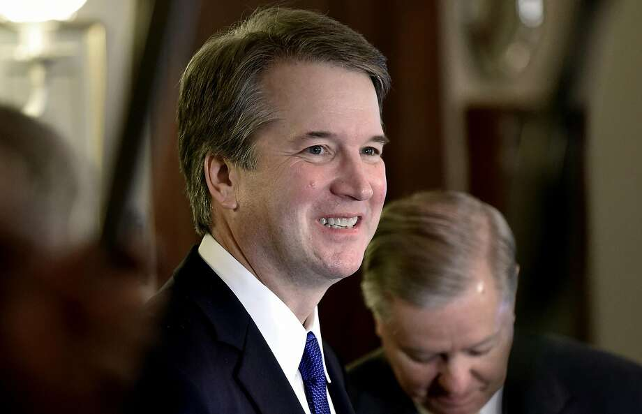 Judge Brett Kavanaugh, President Trump's pick for the U.S. Supreme Court, meets with Sen. Lindsey Graham (R-SC). Photo: Olivier Douliery / Tribune News Service