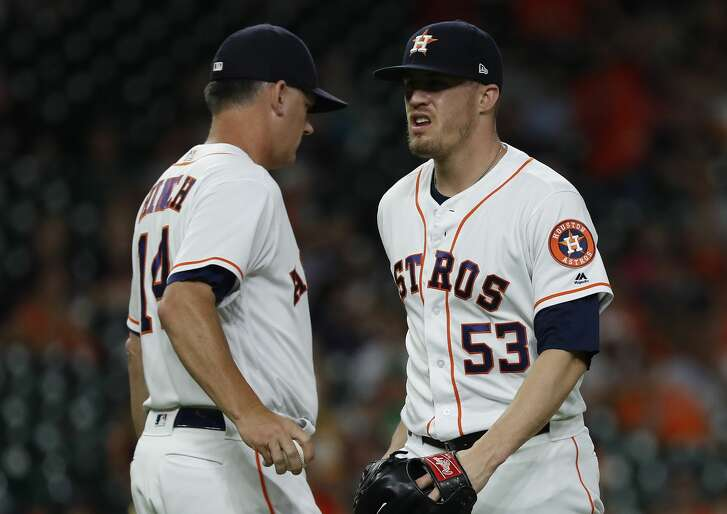 Houston Astros relief pitcher Ken Giles (53) reacts as he hands the ball to manager AJ Hinch as he exited the game during the ninth inning of an MLB game at Minute Maid Park, Tuesday, July 10, 2018, in Houston. ( Karen Warren  / Houston Chronicle )