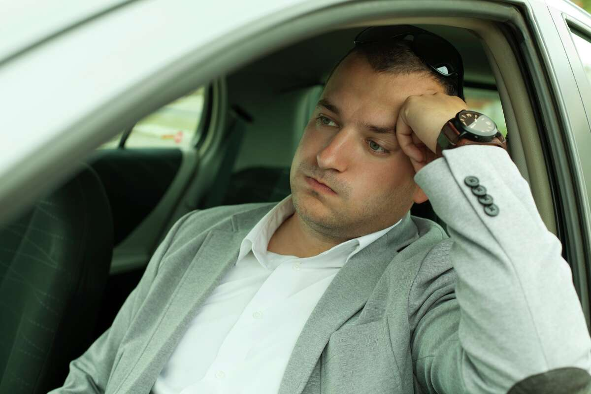businessman late for work because of traffic jams