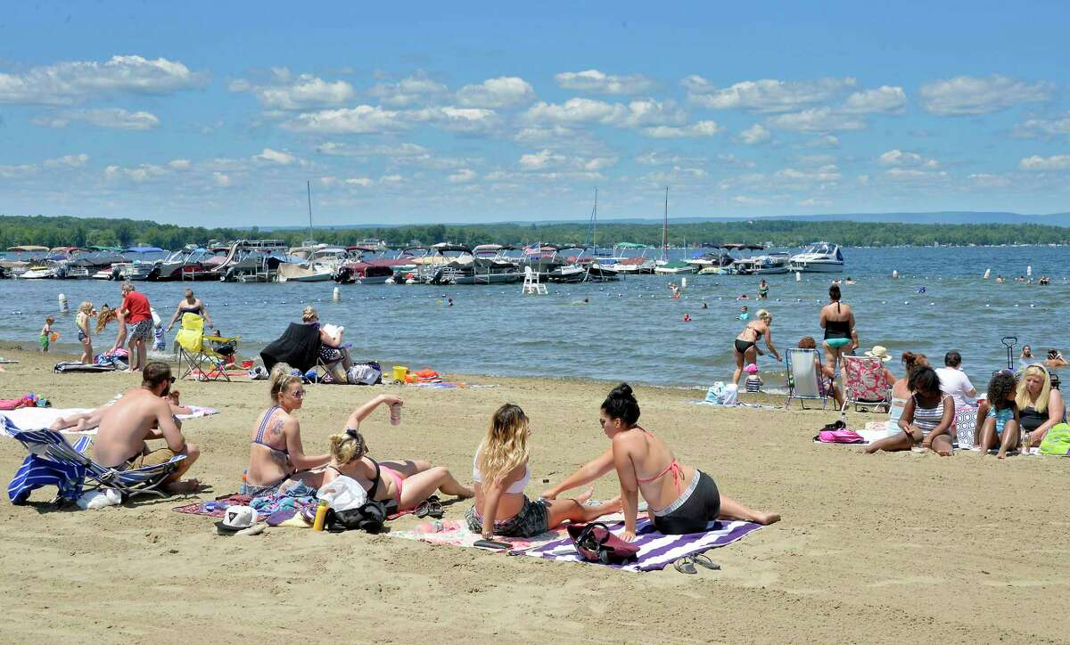 Bathers enjoy a perfect summer day at Brown's Beach on Saratoga Lake Wednesday July 11, 2018 in Stillwater, NY. (John Carl D'Annibale/Times Union)