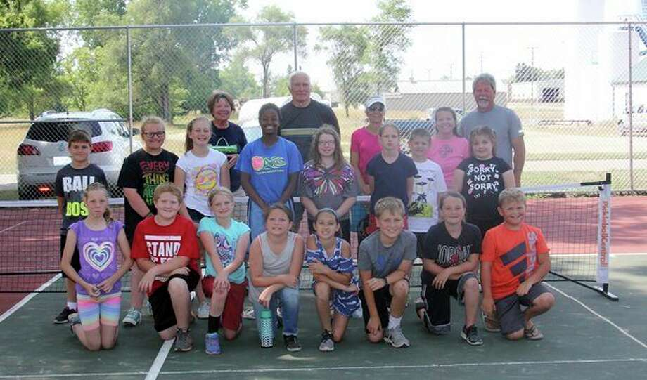 Sixteen kids from the Bad Axe Park and Rec summer program teamed up with a few local talented players Wednesday morning to learn the fundamentals of pickleball, which is a game resembling tennis in which players use paddles to hit a perforated plastic ball over a net. (Bradley Massman/Huron Daily Tribune)