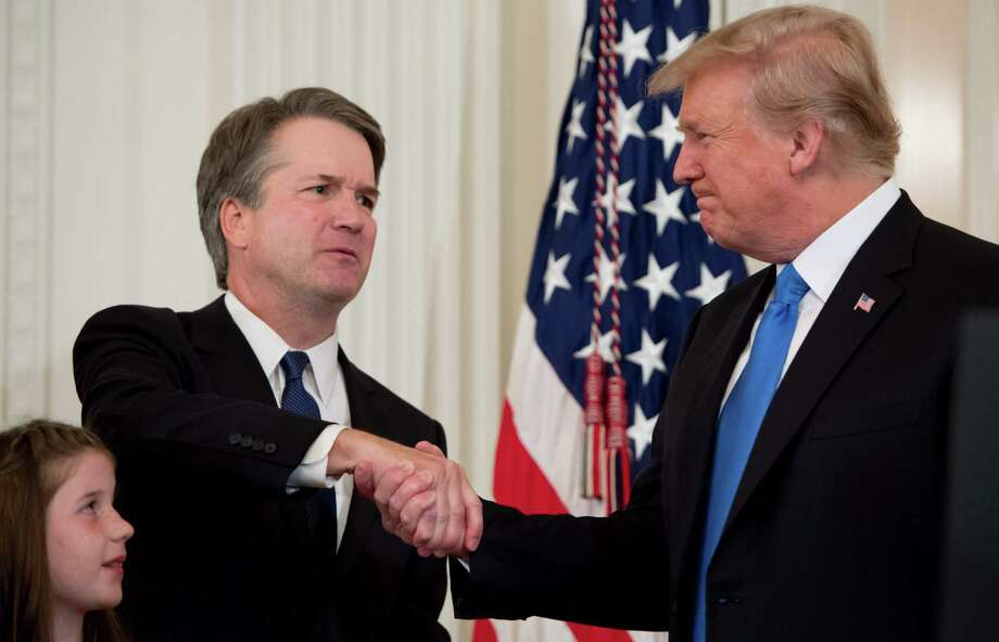 U.S. Judge Brett Kavanaugh shakes hands with President Donald Trump after being nominated to the Supreme Court July 9. Photo: SAUL LOEB / AFP /Getty Images / AFP or licensors
