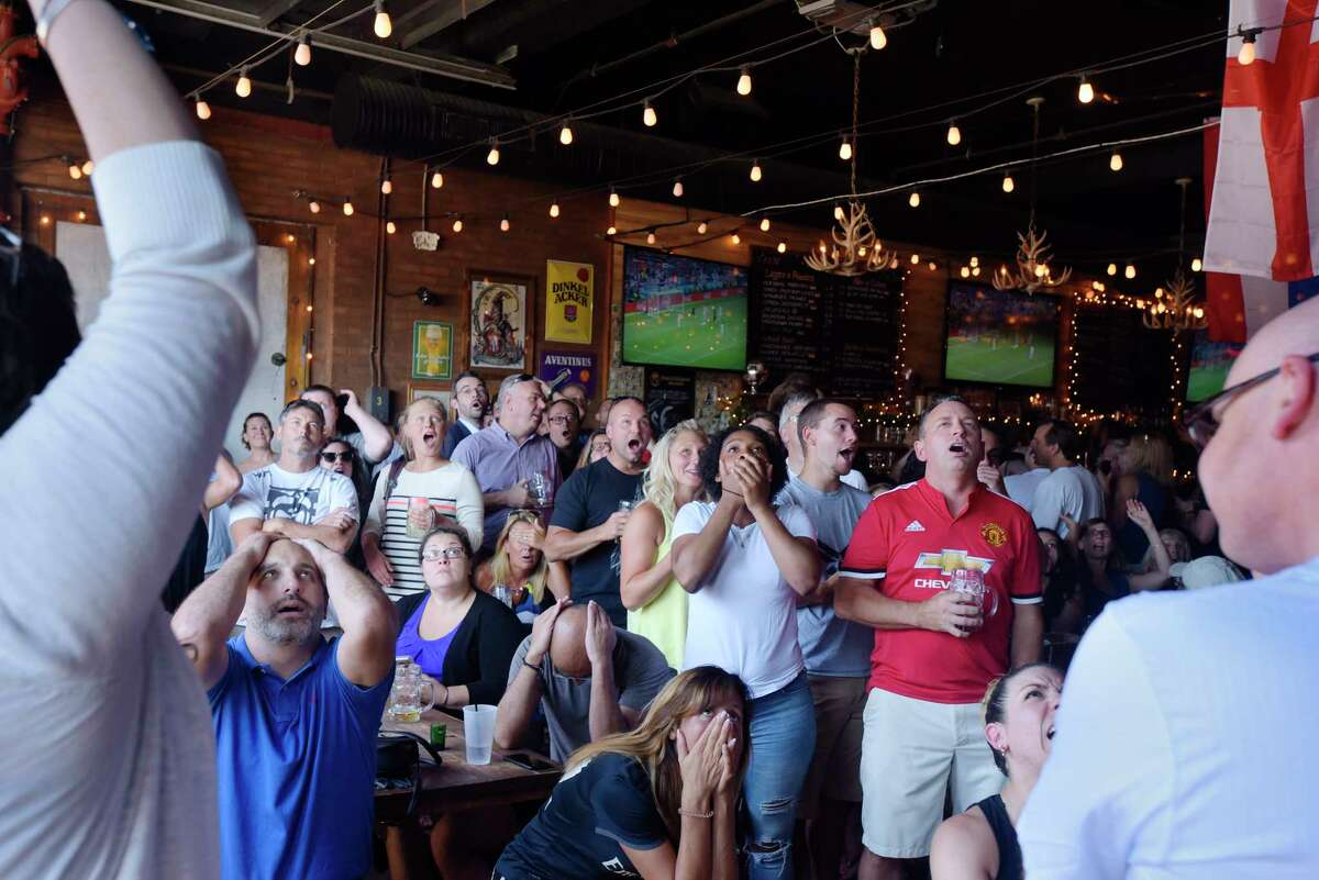 Soccer fans react as Croatia scores to tie the game as they watch the Wold Cup semifinal game between England and Croatia at Wolff's Biergarten on Wednesday, July 11, 2018, in Albany, N.Y. (Paul Buckowski/Times Union)