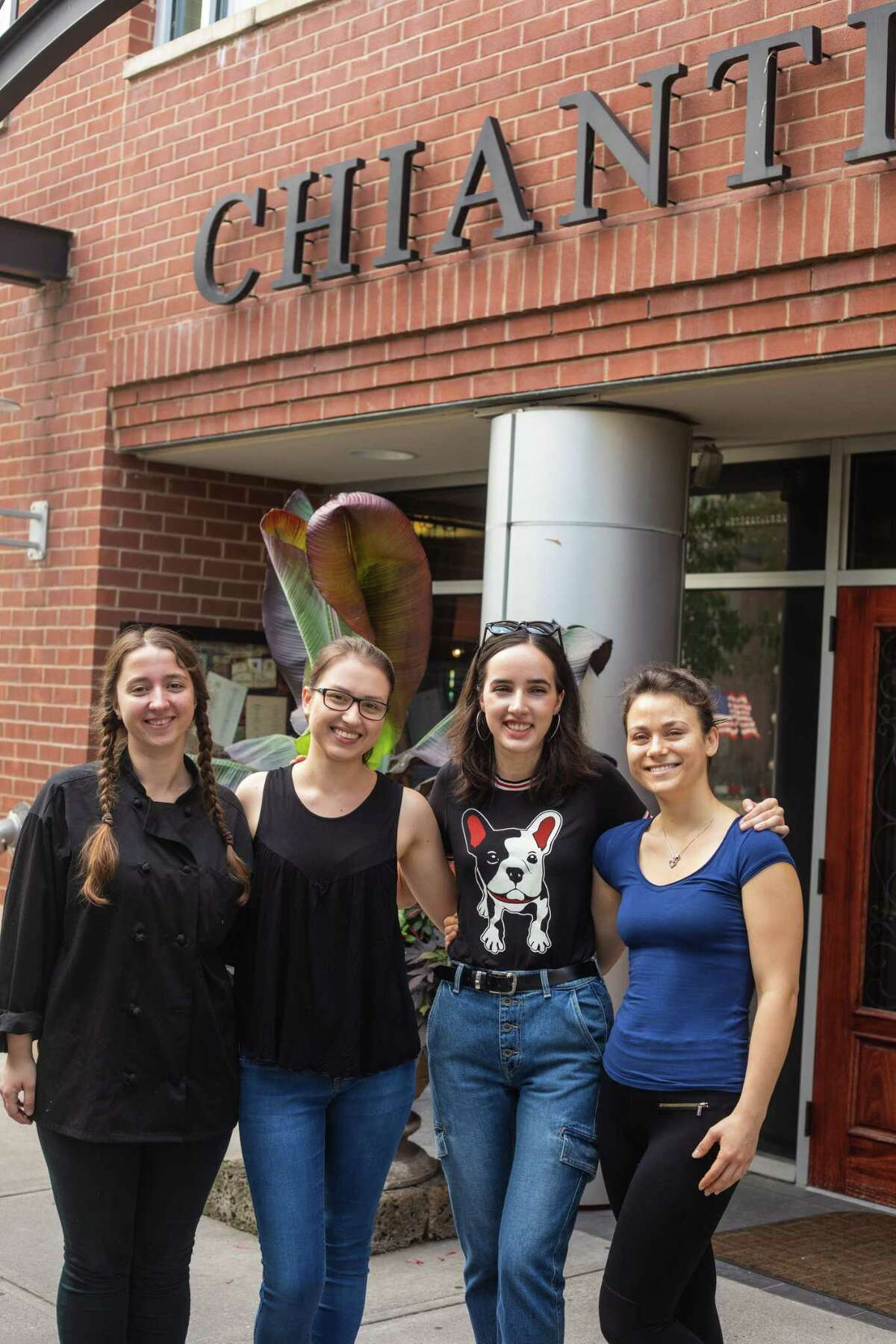 From left, Svitlana Zahorulko, Olga Wyczulkowska, Gabriela Pazdur and Angelika Wloch in front Chianti restaurant in Saratoga Springs. The women are among seven employees, all from Poland, that Chianti's parent company, DZ Restaurants, brought over for the summer to address a labor shortage.