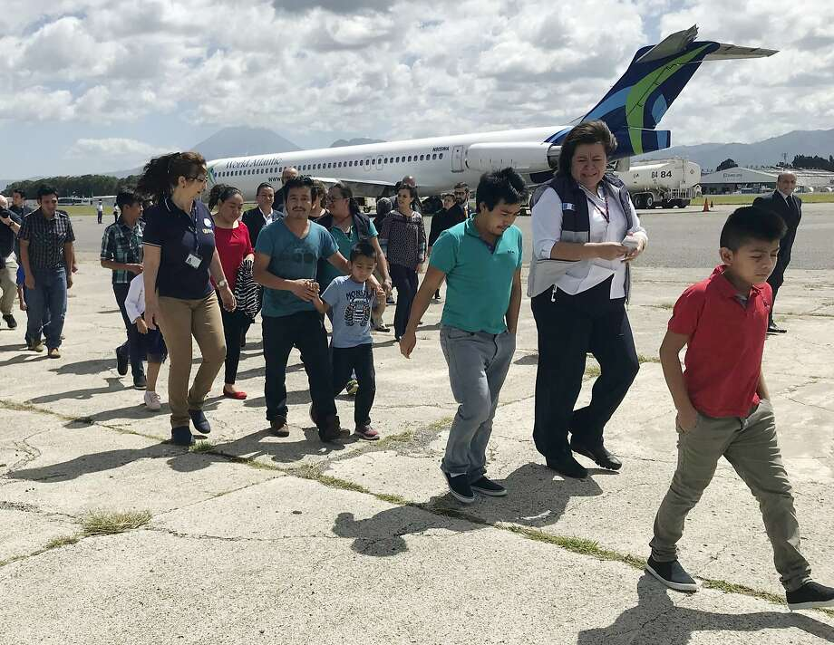 Eleven families, separated in the U.S. under President Trump's zero tolerance policy, return home to Guatemala City, Guatemala, after being deported from the United States. Photo: Colleen Long / Associated Press
