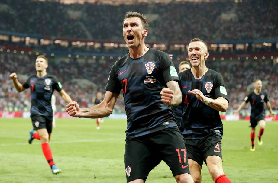 Croatia's Mario Mandzukic celebrates after scoring his side's second goal during the semifinal match between Croatia and England at the 2018 soccer World Cup in the Luzhniki Stadium in Moscow, Russia, Wednesday, July 11, 2018. (AP Photo/Frank Augstein) Photo: Frank Augstein, Associated Press / Copyright 2018 The Associated Press. All rights reserved