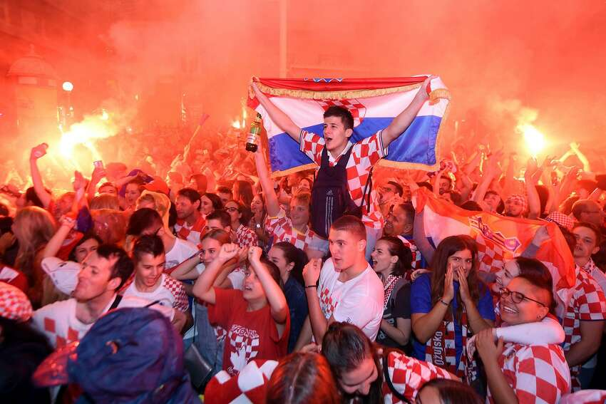 Croatia's supporters celebrate the second goal as they watch on a giant screen the Russia 2018 World Cup semi-final football match between Croatia and England, at the main square in Zagreb on July 11, 2018.