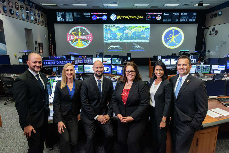 NASA's Johnson Space Center named six new Mission Control flight directors in July 2018. Pictured L-R) are Marcos Flores, Allison Bolinger, Adi Boulos, Rebecca Wingfield, Pooja Jesrani, and Paul Konyha. Photo: NASA/Robert Markowitz / Robert Markowitz / NASA - Johnson Space Center