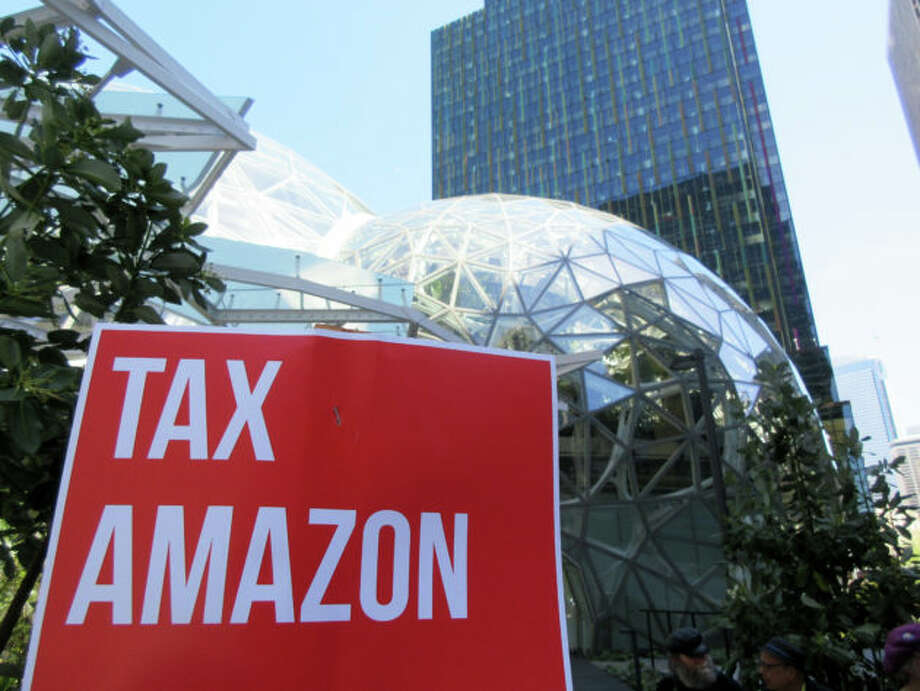 "Affordable housing advocates have held several events in support of the ""head tax"" at Amazon's Seattle headquarters. Photo: Kurt Schlosser/GeekWire"