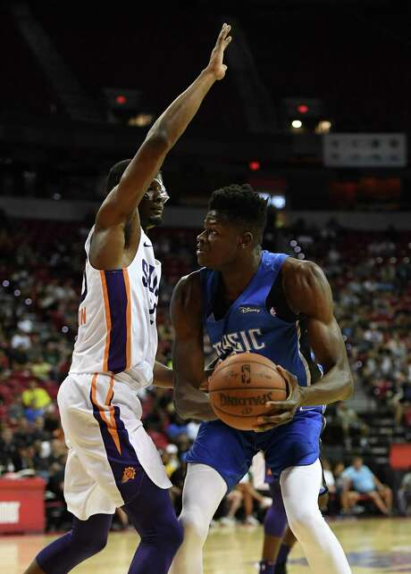 LAS VEGAS, NV - JULY 09:  Mohamed Bamba #5 of the Orlando Magic is guarded by Josh Jackson #20 of the Phoenix Suns during the 2018 NBA Summer League at the Thomas & Mack Center on July 9, 2018 in Las Vegas, Nevada. The Suns defeated the Magic 71-53. NOTE TO USER: User expressly acknowledges and agrees that, by downloading and or using this photograph, User is consenting to the terms and conditions of the Getty Images License Agreement.  (Photo by Ethan Miller/Getty Images) Photo: Ethan Miller, Staff / Getty Images / 2018 Getty Images