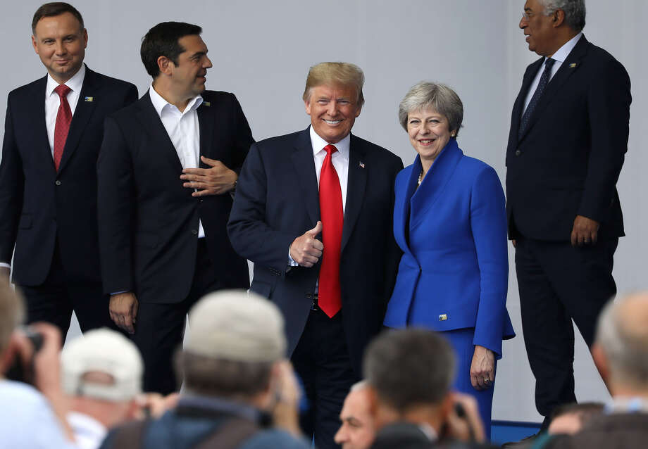 President Trump, center left, sidled up to British Prime Minister Theresa May, whom he had undermined a day earlier by praising her domestic rival, Boris Johnson, during a photo session at the NATO summit in Brussels on Wednesday. Photo: Bloomberg Photo By Marlene Awaad / Bloomberg