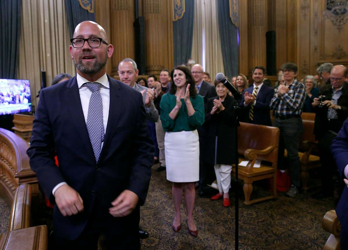 Rafael Mandelman smiles after he is sworn in by City Attorney Dennis Herrera as Supervisor for District 8 at City Hall in San Francisco, Calif. on Wednesday, July 11, 2018.