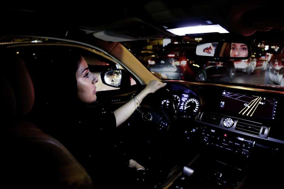 Hessah al-Ajaji drivers her car down the capital's busy Tahlia Street after midnight for the first time in Riyadh, Saudi Arabia, Sunday, June 24, 2018. Saudi women are in the driver's seat for the first time in their country and steering their way through busy city streets just minutes after the world's last remaining ban on women driving was lifted on Sunday. Photo: Nariman El-Mofty, STF / Associated Press / Copyright 2018 The Associated Press. All rights reserved.