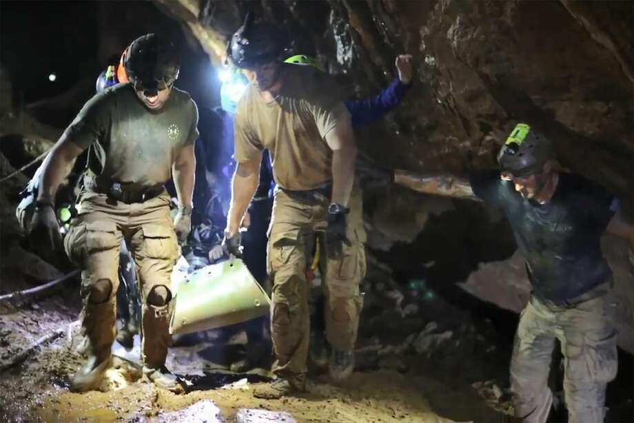 """This handout video grab taken from footage released by the Royal Thai Navy on July 11, 2018 shows rescue personnel  carrying a member of the """"Wild Boars"""" Thai youth football team on a stretcher during the rescue operation inside the Tham Luang cave in Khun Nam Nang Non Forest Park in Mae Sai district. The 12 boys rescued from a Thai cave were passed """"sleeping"""" on stretchers through the treacherous passageways, a former Thai Navy SEAL told AFP on July 11, giving the first clear details of an astonishing rescue mission that has captivated the world. / AFP PHOTO / ROYAL THAI NAVY / Handout / RESTRICTED TO EDITORIAL USE - MANDATORY CREDIT """"AFP PHOTO / Royal Thai Navy """" - NO MARKETING NO ADVERTISING CAMPAIGNS - DISTRIBUTED AS A SERVICE TO CLIENTSHANDOUT/AFP/Getty Images Photo: HANDOUT, AFP/Getty Images"""