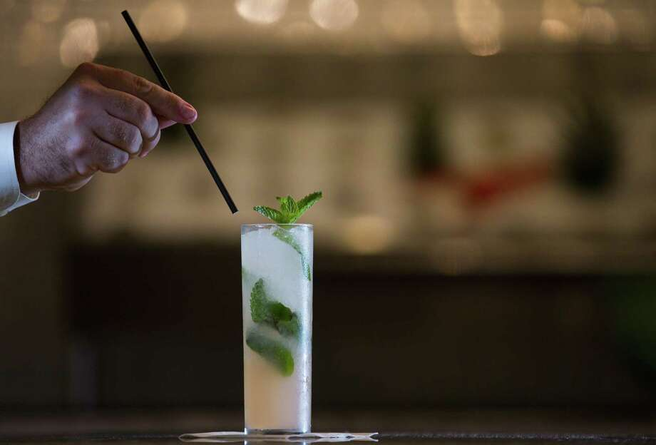 Liberty Kitchen & Oysterette on San Felipe is currently using paper straws instead of plastic for cocktails. Photo: Mark Mulligan, Staff / Houston Chronicle / © 2018 Houston Chronicle