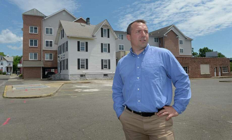 Jason Milligan of Milligan Realty in front of his newly acquired property at 21 and 23 Isaac Street Thursday, June 21, 2018, in Norwalk, Conn. The frustrated, decade-long effort to fill in central Wall Street with new apartments, parking and street-level retail got more complicated when the city and Norwalk Redevelopment Agency sued the two parties involved in a land transfer involving key parcels within the area of the stalled redevelopment project known as Wall Street Place. Photo: Erik Trautmann / Hearst Connecticut Media / Norwalk Hour