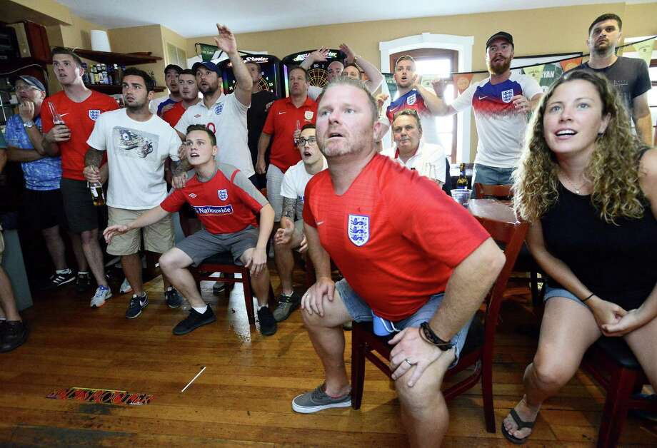 Alistair Lonsdale of Stamford, second from right, reacts as fans of England watch the match between Croatia on Wednesday. A large group of English fans gathered to watch the semi final match in the 2018 Fifa World Cup at Casey's Tavern in Stamford, Connecticut. Photo: Matthew Brown / Hearst Connecticut Media / Stamford Advocate