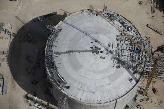 Work continues on a tank at the Cheniere Liquid Natural Gas plant under construction in Portland, Texas, Tuesday, Aug. 8, 2017.