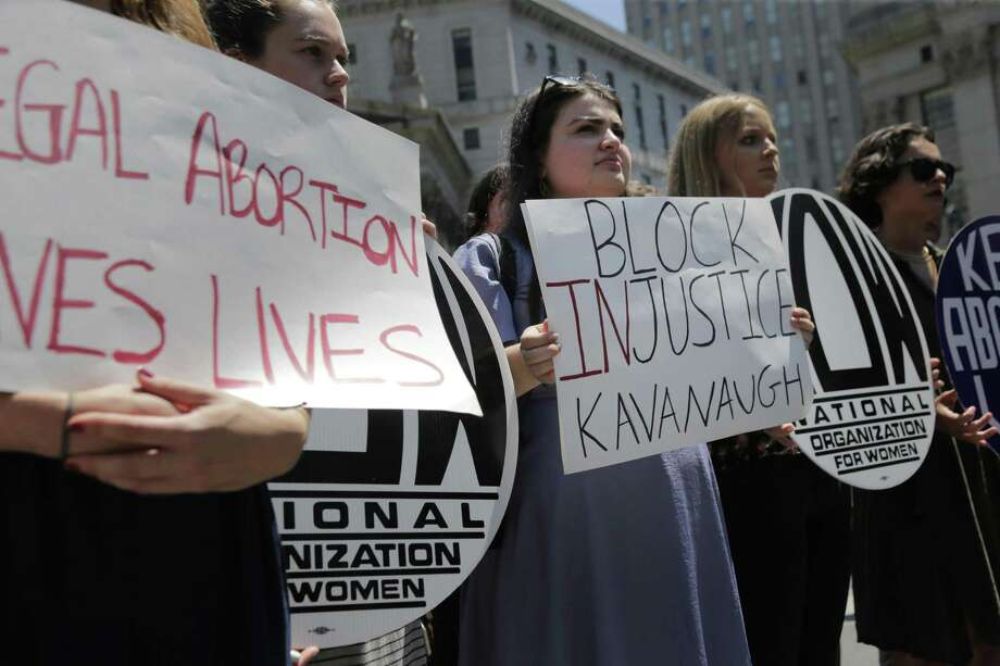 People hold signs at a rally opposing supreme court nominee Brett Kavanaugh in New York Tuesday. Democrats need to realize that the mid-term elections, not opposing this nomination, is the most important struggle ahead. Photo: Seth Wenig /Associated Press / Copyright 2018 The Associated Press. All rights reserved.