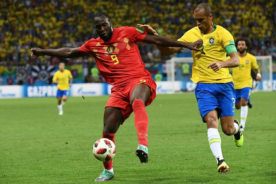 Romelu Lukaku (left, against Brazil's Miranda in the quarterfinals) is one of several young talents who are in their prime ahead of the 2020 European championships. Photo: Jewel Samad / AFP / Getty Images